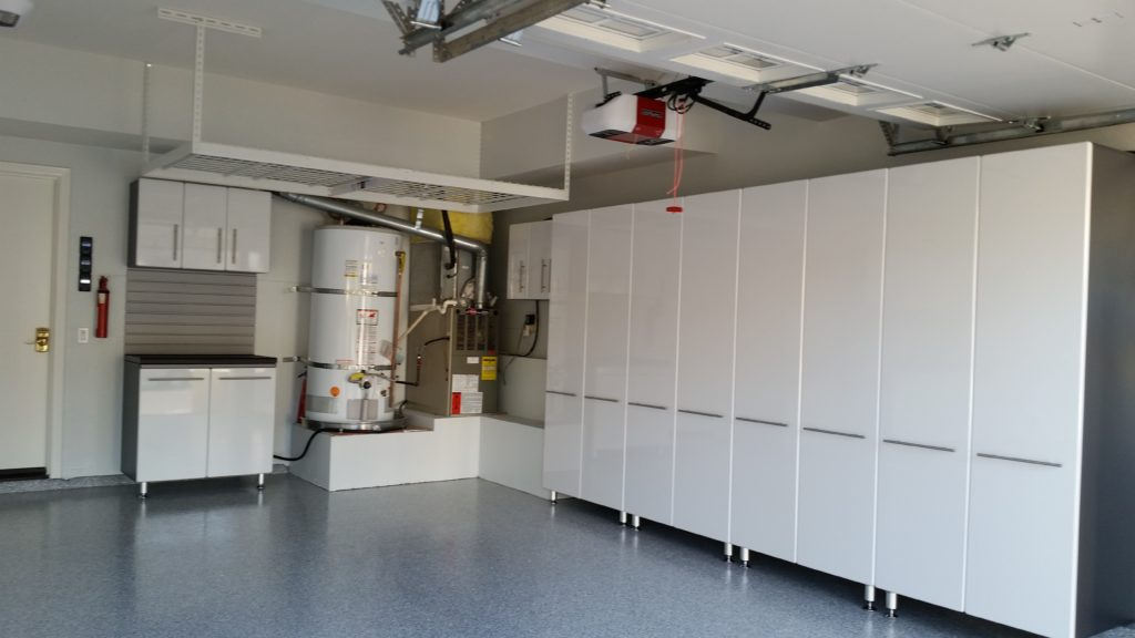 ... White Garage Cabinets With Slat Wall And Epoxy Coated Floors ...