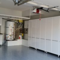 White Garage Cabinets with Slat Wall and Epoxy Coated Floors